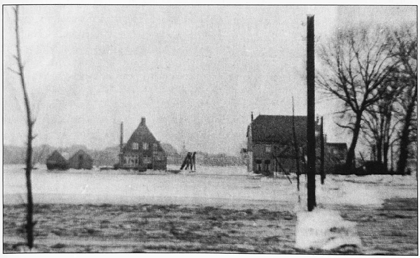 Een gezicht op het Veerhuis vanaf de Waalbandijk. De woning links was het huis van veerbaas Blydesteyn.
